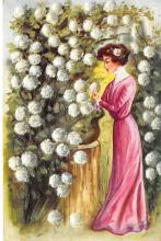 sub000463 - Woman standing by white flowers