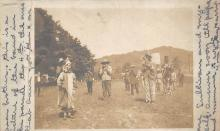 sub014791 - People playing instruments in a field  Postcard