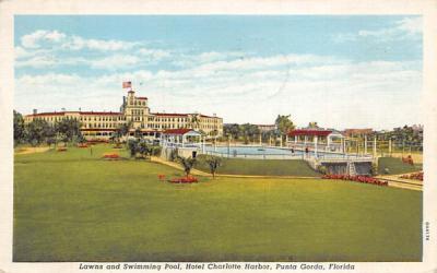 Lawns and Swimming Pool, Hotel Charlotte Harbor Punta Gorda, Florida Postcard