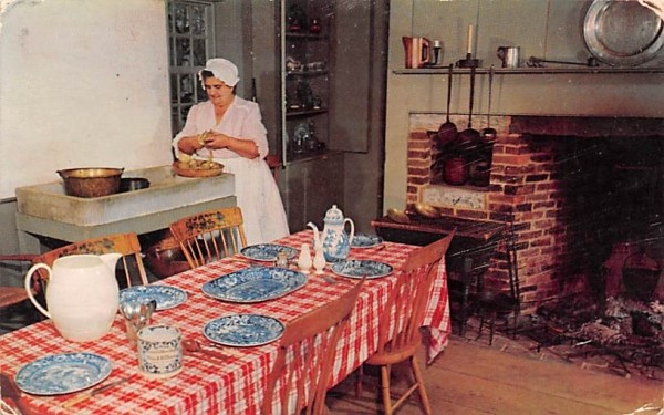 Table is set with flow-blue Sturbridge, Massachusetts Postcard