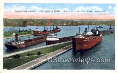 Freighters waiting their turn to enter the locks - Sault Ste Marie, Michigan MI Postcard