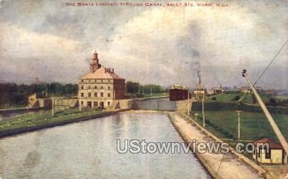 Ore boats locking through canal - Sault Ste Marie, Michigan MI Postcard