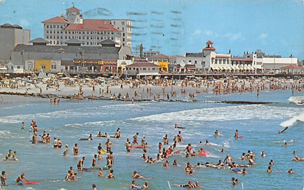 ocean surf, bathers in front of beach and skyline Ocean City, New Jersey Postcard