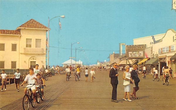 Bicycling and strolling on the boardwalk Ocean City, New Jersey Postcard
