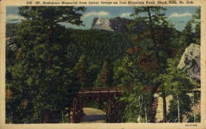 Mt. Rushmore from Spriral Bridge on Iron Mt. Road - Mount Rushmore, South Dakota SD Postcard